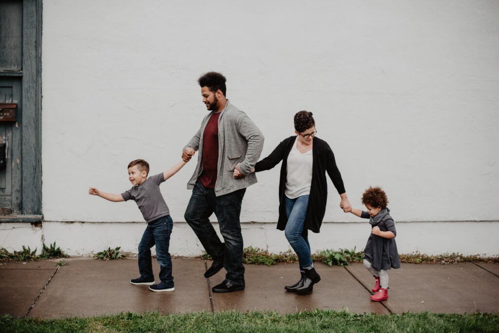 family immigration is possible (photo of mixed race family walking down sidewalk)